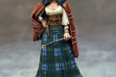 Darksword Miniatures Witch with a wand in plaid skirt.
